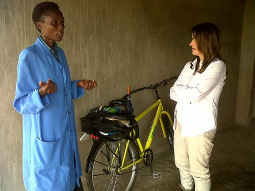 A newly qualified Community Health Assistant meets with Lynne Featherstone International Development Minister Lynne Featherstone meets with a newly qualified Community Health Assistant and travels with her to a household in a rural location. The assistant shows the Minister her bike, provided by the Ministry of Health in Zambia, which she uses to visit rural families in Monze, Southern Province. UK aid is training a new cadre of 300 Community Health Assistants to deliver health services in rural areas.